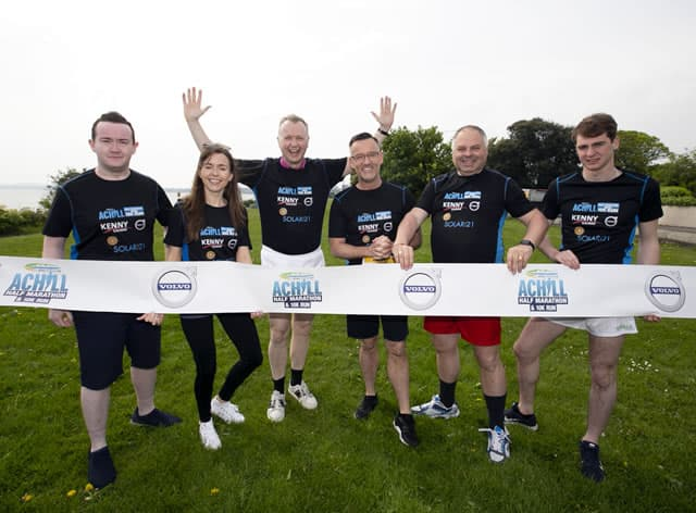 Presenters Matt Cooper and Brendan Courtney with representatives of Achill Tourism and Achill Half Marathon at the official launch of the 2019 Achill Half Marathon & 10K, May 2019