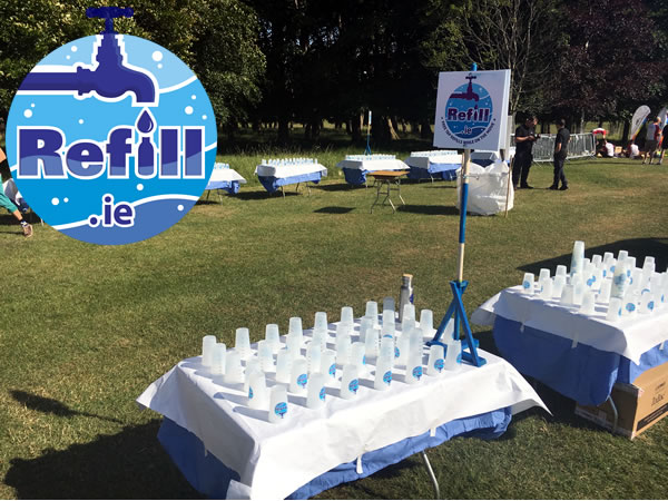 Refill Ireland logo & tables with reusable water cups